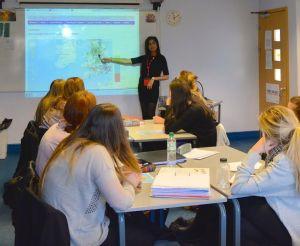Alisha Bhagat (third year, English Language) teaches year 13 pupils about dialect diversity, Altrincham Girls' Grammar.