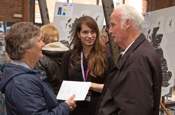Kathleen Easlick (centre) chats with visitors about dialect variation.
