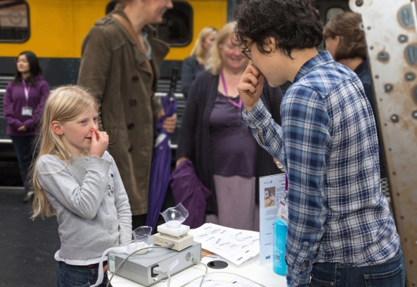 Natasha Hirata-Smith helps a young visitor discover how and why her speech sounds funny when she has a cold.
