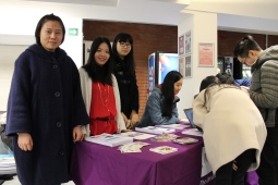 Student volunteers at the welcome desk.